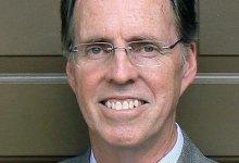 Principal Alleges Religious Discrimination