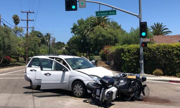 Motorcycle Cop Hit by Novice Driver