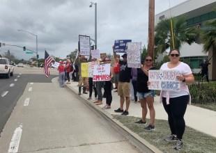 Dozens Rally Against Medical Worker Vaccine Mandate
